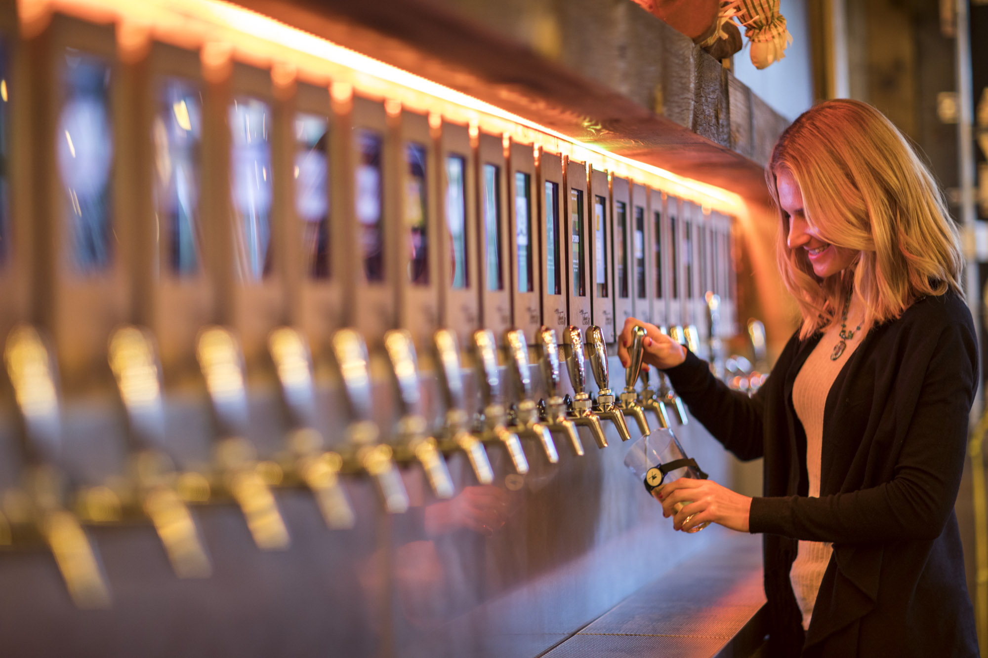 woman tries an electronic beer tap