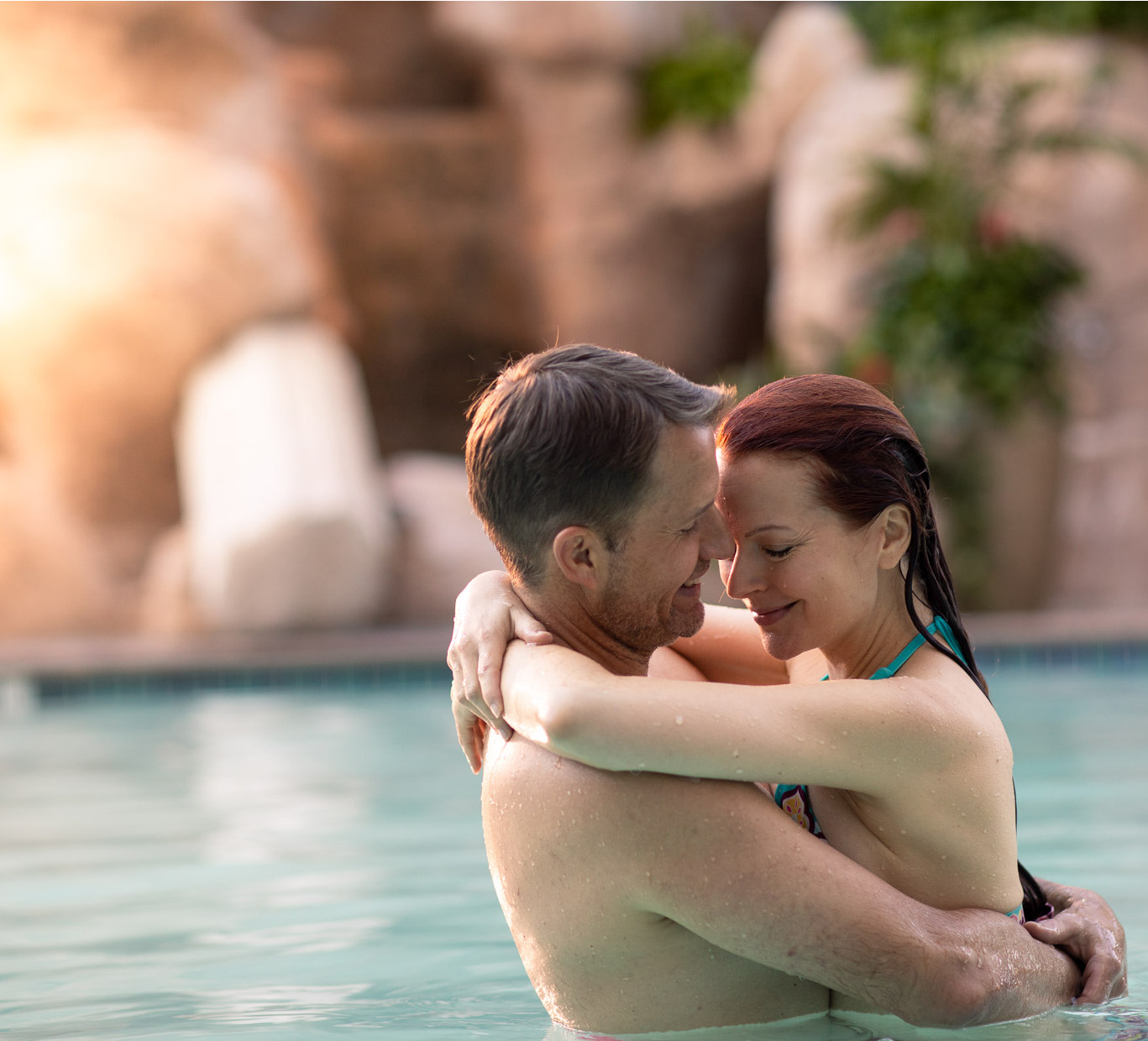 Couples embrace in a pool