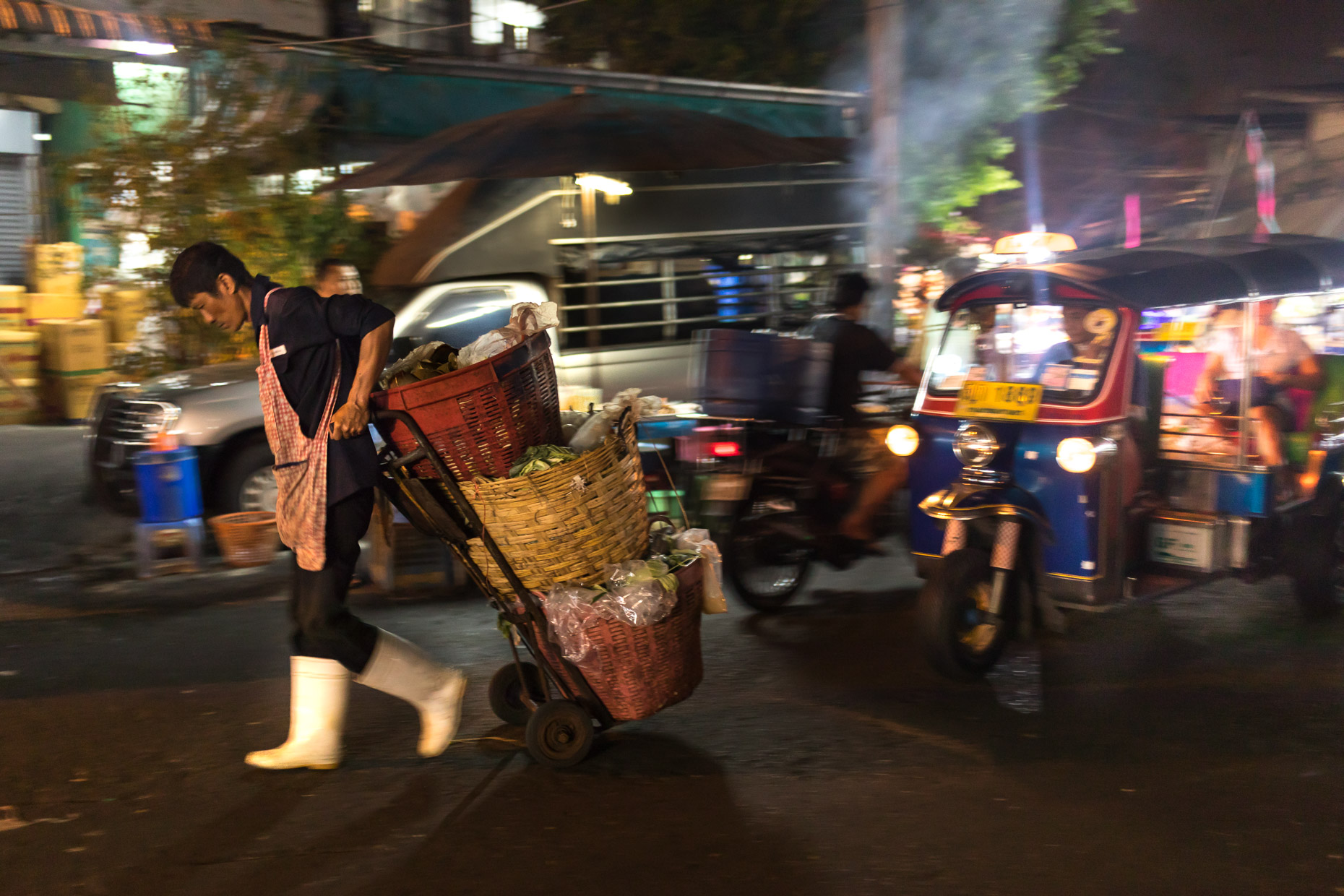 Early morning activity at an open air market in Thailand