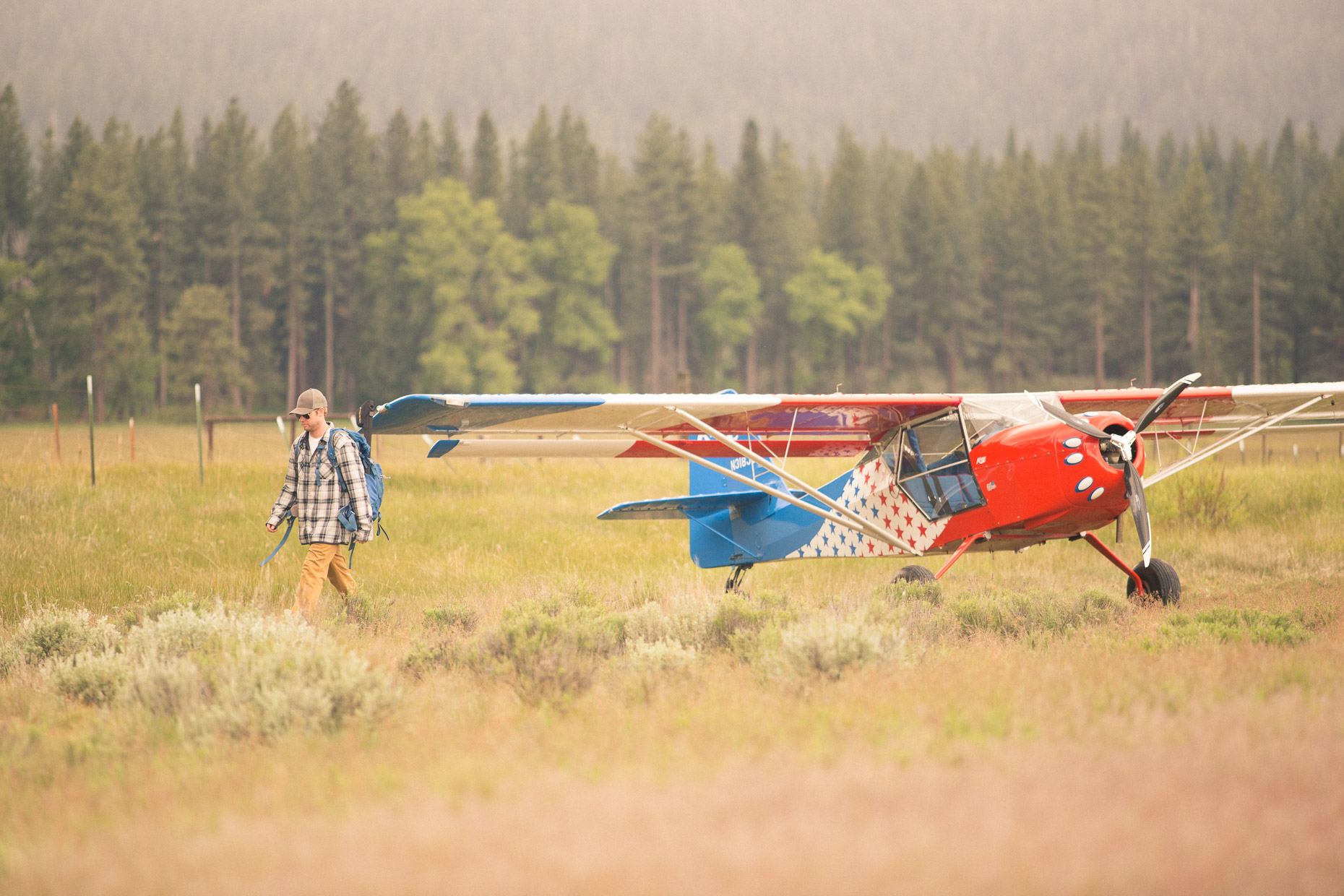 Man leaves his bush plane to Fly fishing on a stream in the Sierra Nevada
