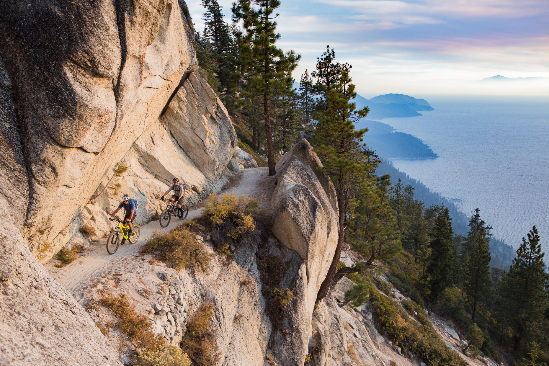 Mountain bikers brave the edge of the legendary Flume Trail at Lake Tahoe