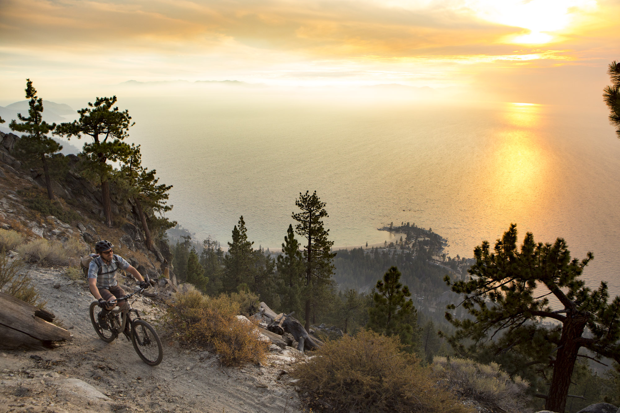 Mountain bikers skirt the edge on Lake Tahoe