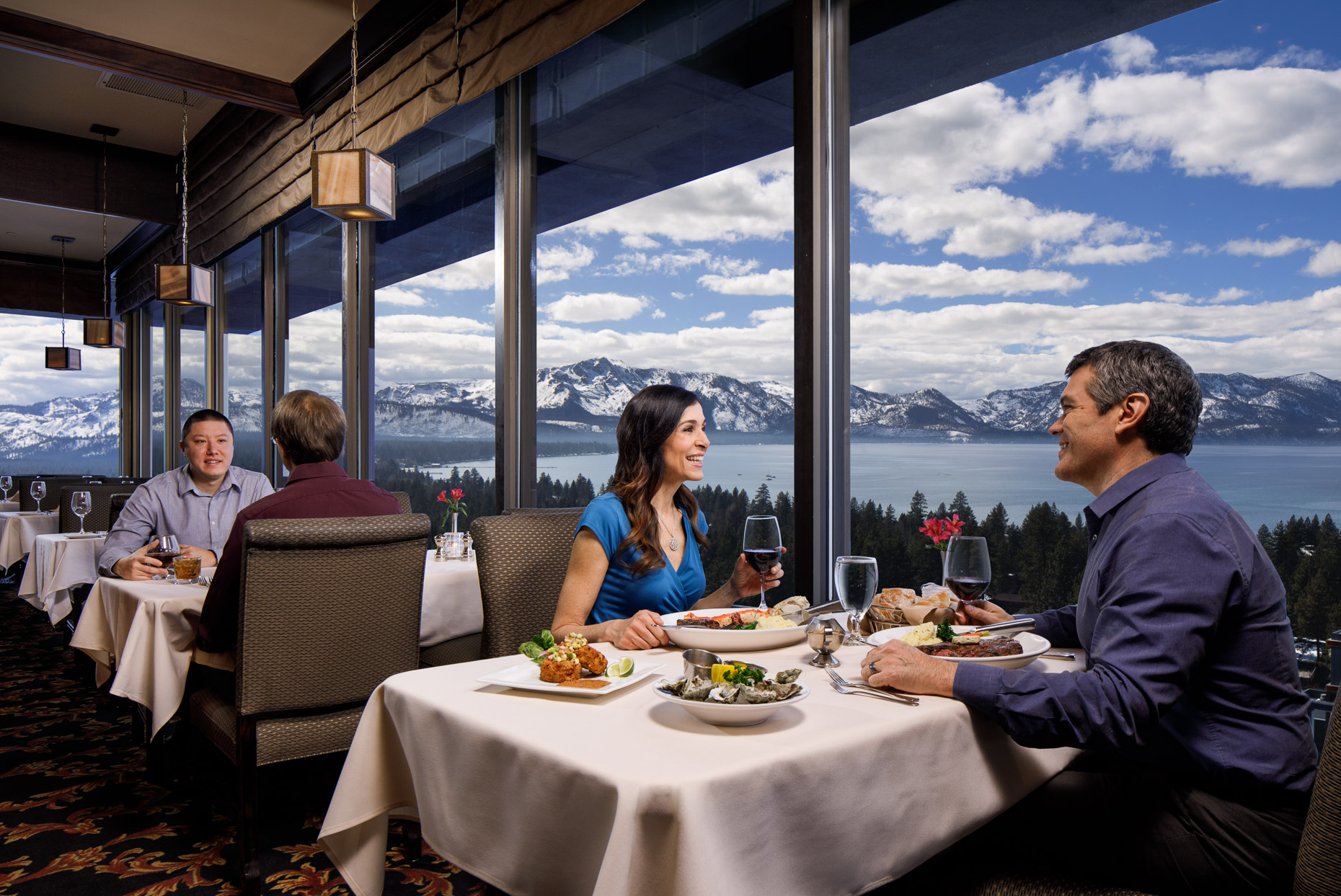 Couple enjoy a meal with a view of Lake Tahoe