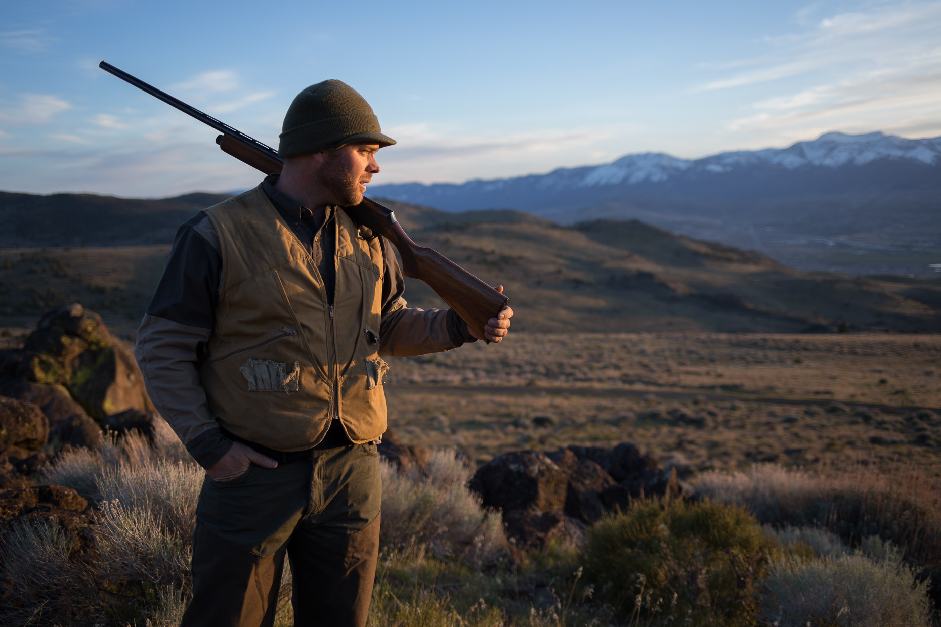Man walks through the Nevada backcountry hunting Chukar
