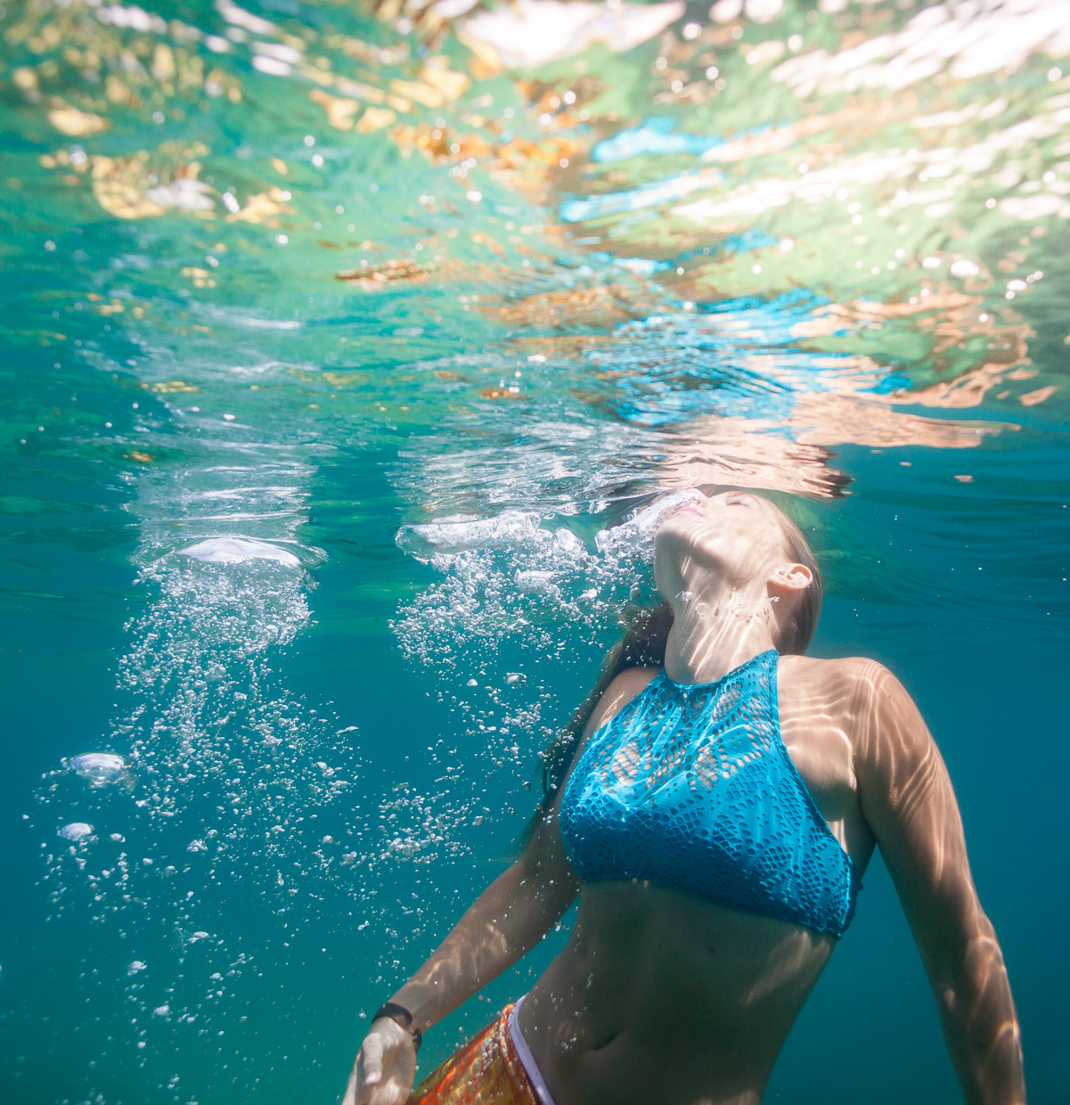 Women swims for the surface of water