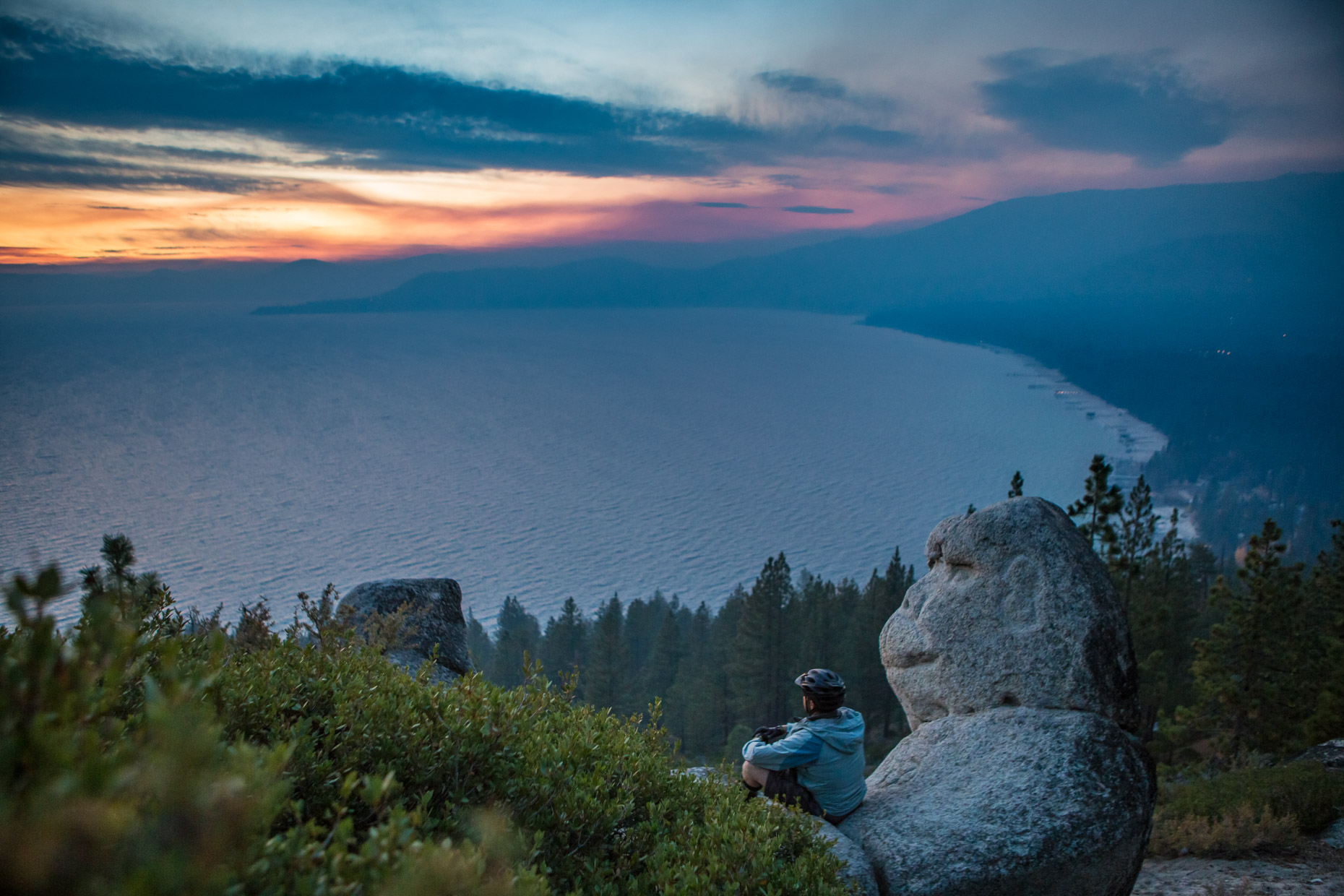 man views lake tahoe from monkey rock