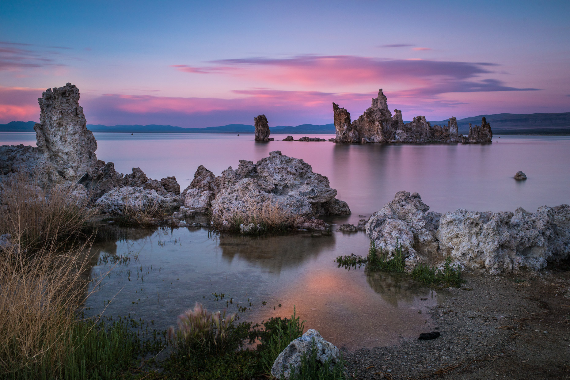 Sun rises over a tufa rock formation in the Nevada desert