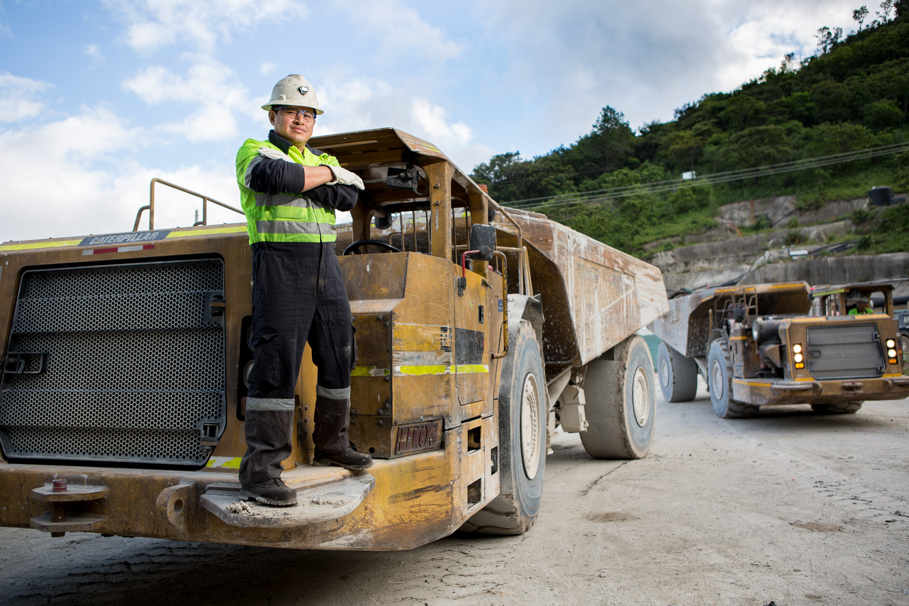 A driver stands for a portrait on his specialized ore truck