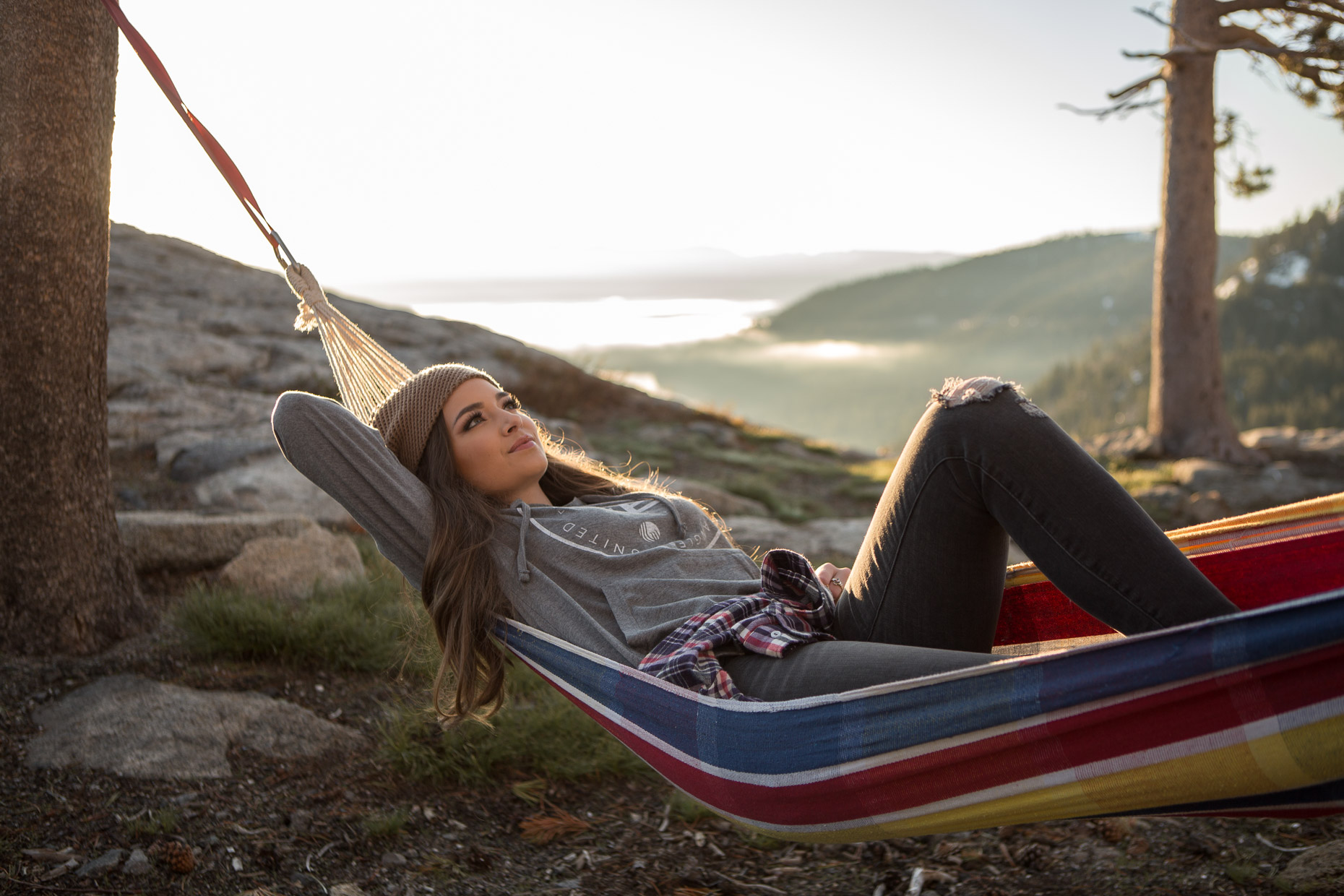woman relaxes in a hammock