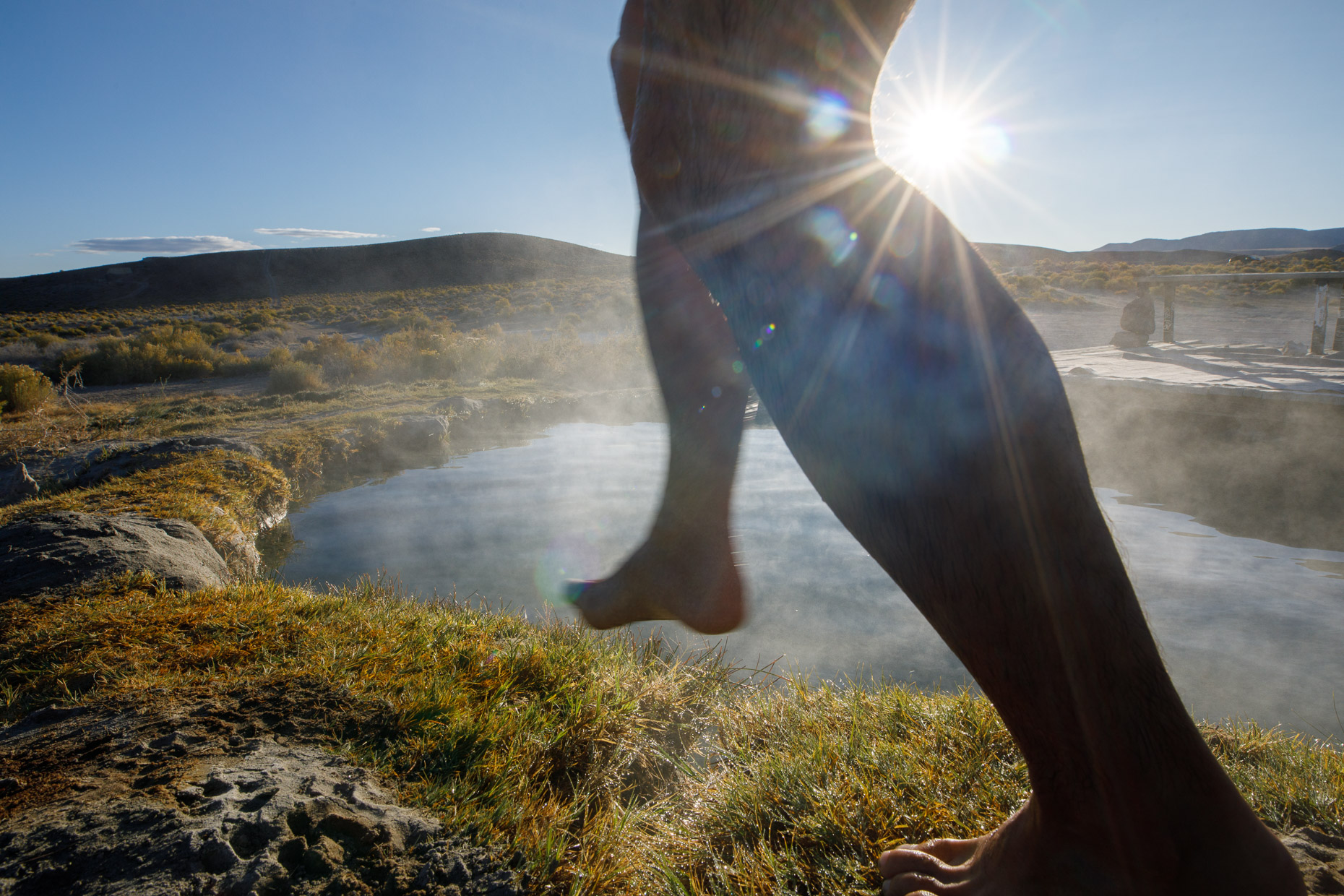 silhouette of legs entering a nevada  hotspring