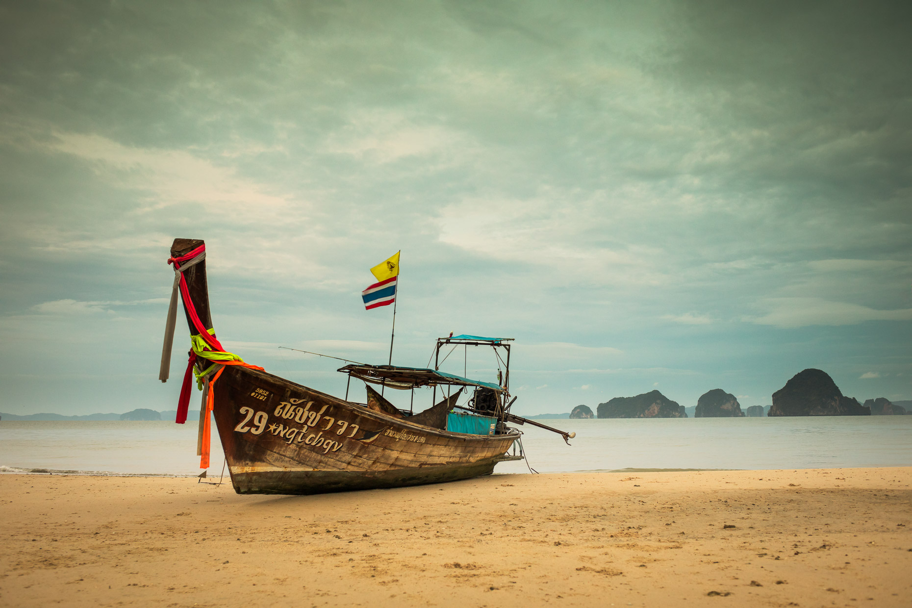 Beached long tail boat in Thailand
