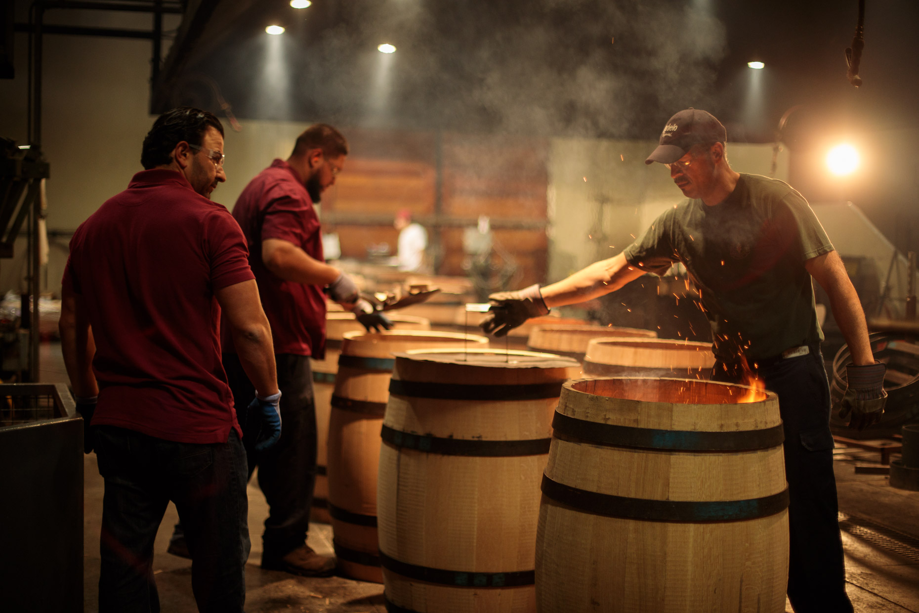 man construct a barrel at a cooperage