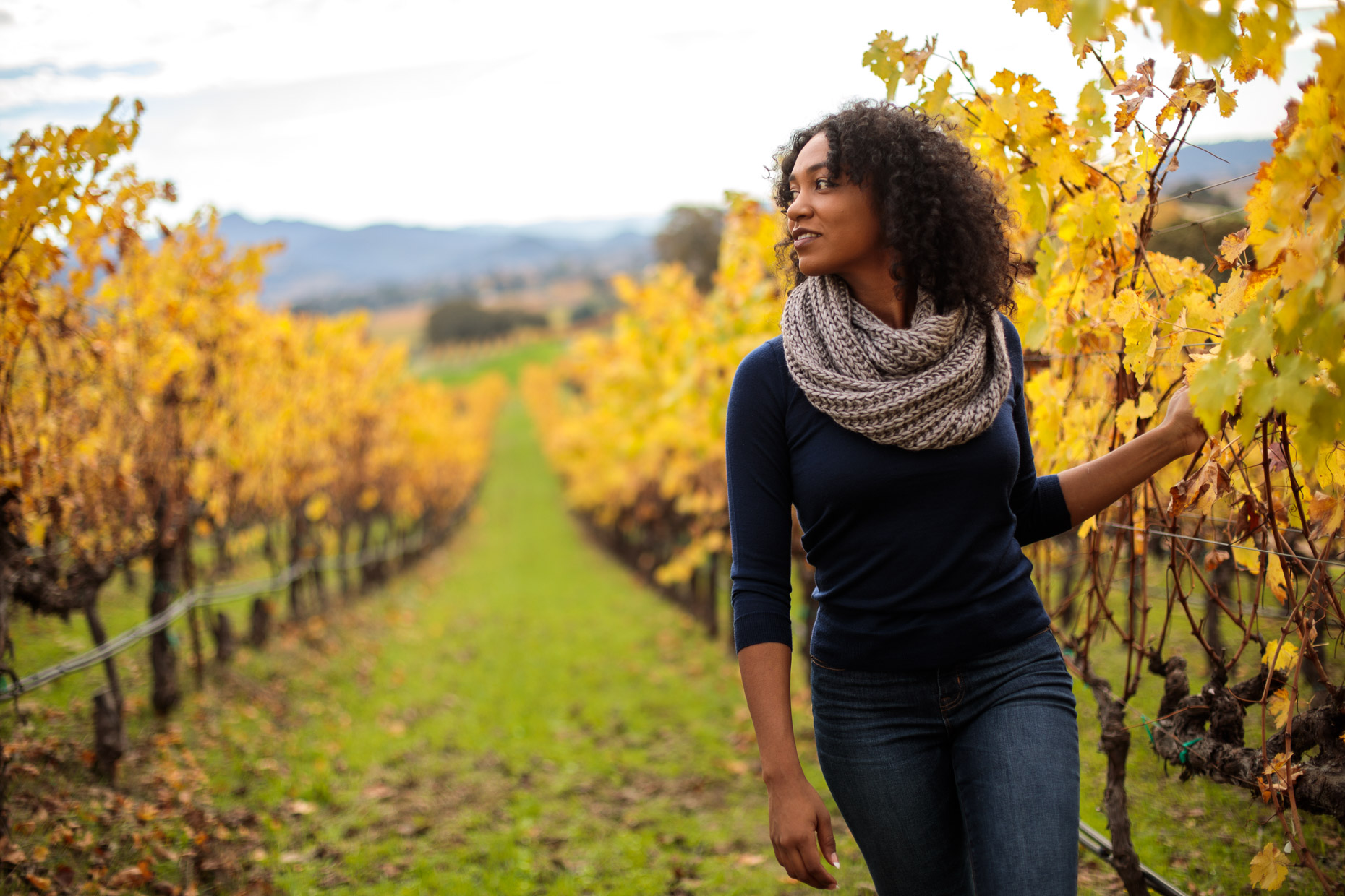 Woman walk through a vineyard