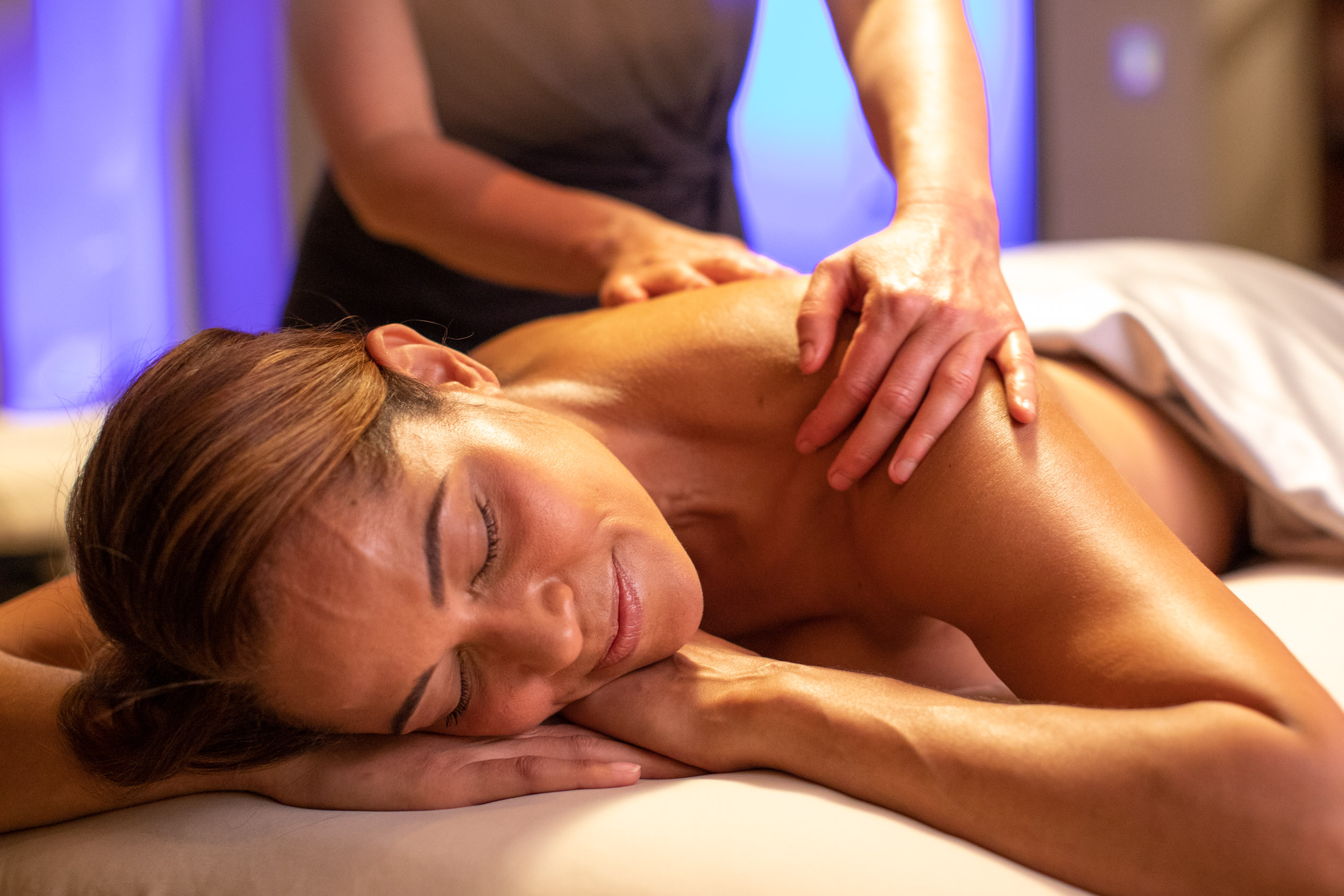 Woman enjoys a massage at a spa