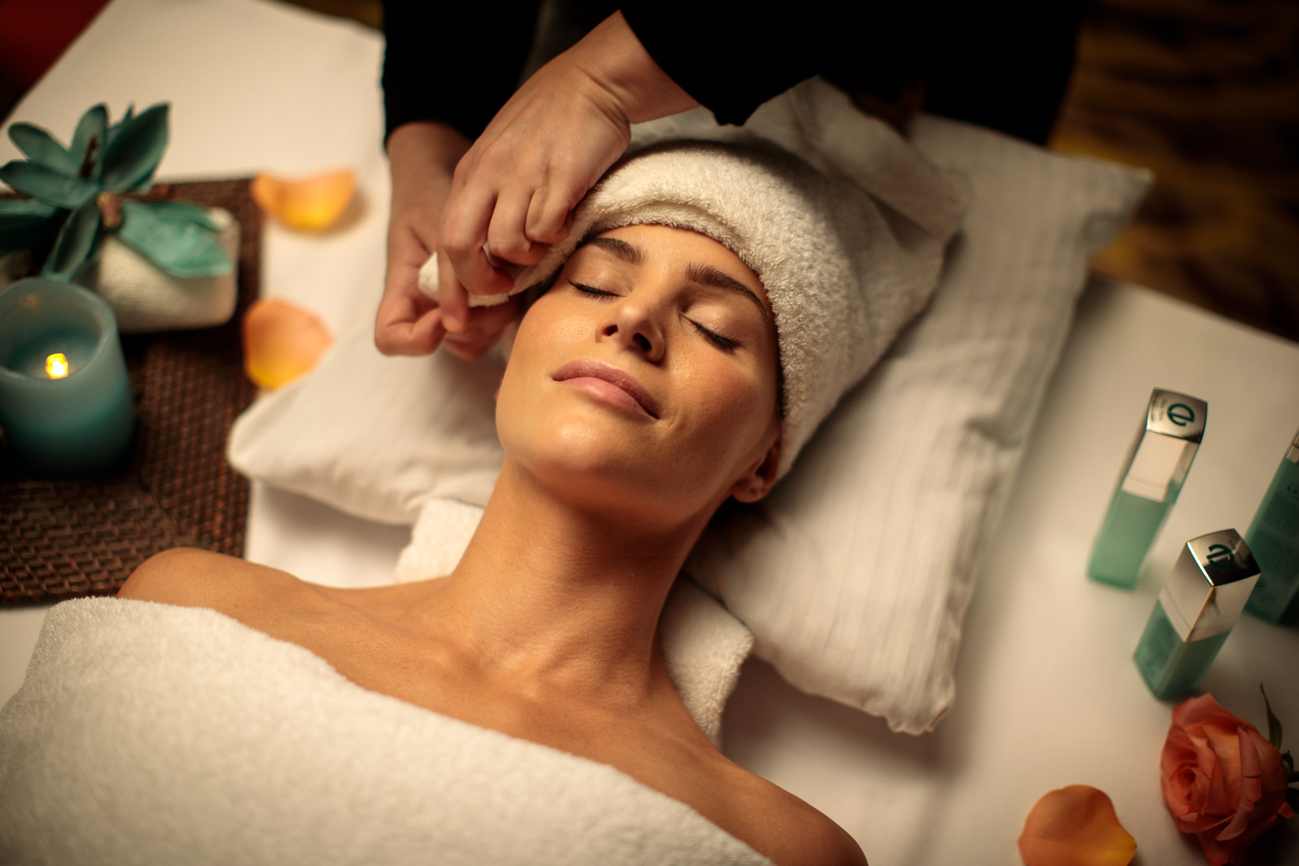 Woman receives a facial at a spa